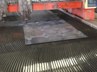 Water jet cut holes in sheet